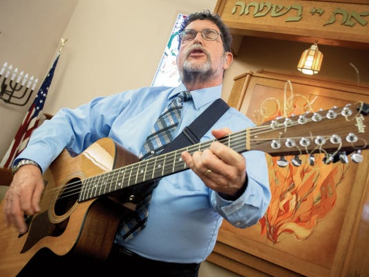 "Rabbi Larry Karol, here singing  at Temple Beth-El, says ""Music has given me extra avenue of expression. I think song sometimes ends up going deeper into a theme."" The singer-songwriter is reaching a wide online audience with ""House of Prayer,"" which has special relevance after murders of members of Emanuel AME Church in South Carolina and church bombings in Las Cruces."