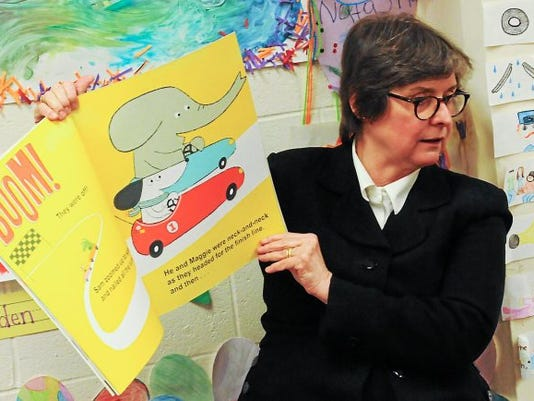 First lady Frances Wolf, wife of Gov. Tom Wolf, reads a book to PEAK pre-K students in their classroom at Pottstown High School in this file photo.