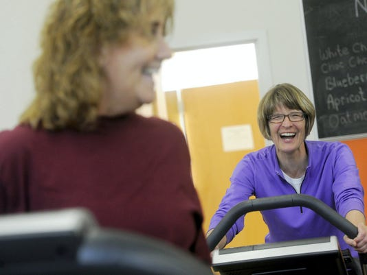 Jan Matthews, left, and Leslie Bentz joke around while working out at the YWCA.