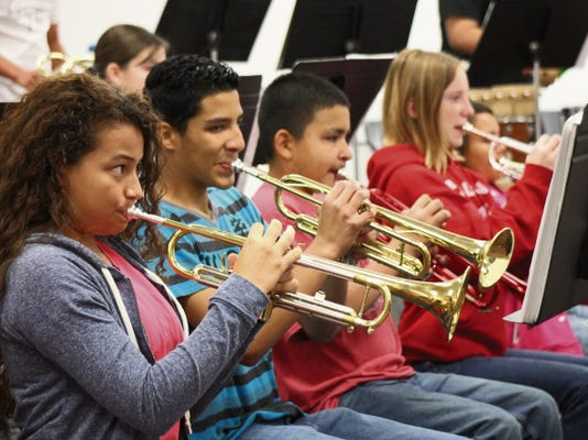"""The Loving Falcon Band rehearses Wednesday for the """"Noodles and Notes"""" performance, which will be at 6 p.m. today at the Loving High School cafeteria."""