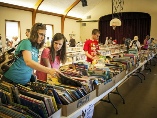 Sarah Eberly of Palmyra and her children, Brooke, 12, and Aaron, 13, browse through the young adult books at the Palmyra Public Library annual book sale on Saturday, July 11 at Palmyra First United Methodist Church at 520 E. Birch St. The event will run Monday-Wednesday from 10 a.m.-8 p.m.. Wednesday is half-price day, and Thursday books are priced at 5 a bag from 9 a.m. until 1 p.m.