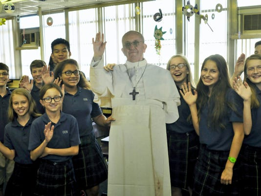 Corpus Christi  School students pose with a cutout of Pope Francis during a break in classes Thursday at the Catholic school. Students spent the week learning about Pope Francis and creating artwork to recognize the Pope's visit to Pennsylvania.