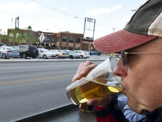 Before he heads across the street to watch a York Revolution game, Jeff Smith of Springettsbury Township sips a beer at BrewVino.