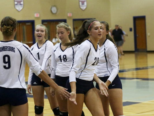 Chambersburg middle hitter Caitlin Vrabel (20) preps for a big Mid Penn Commonwealth Division match against State College. Despite losing the first set, the Trojans came back for a 3-1 victory on Monday night.