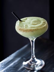 Enormously popular, the Avocado Margarita at AVO  is a wonder of a drink — an adult smoothie whipping avocado with resposado tequila, cilantro, lime, agave and orange.