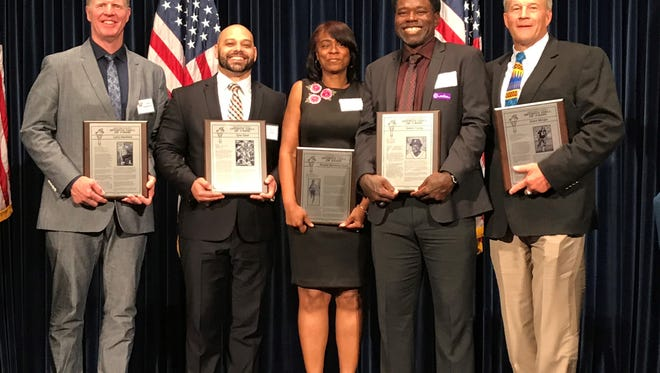 The 2018 Ventura County Hall of Fame class poses with the plaques after the induction ceremony Sunday night at the Ronald Reagan Library in Simi Valley: Larry Hamilton (left to right), Tyler Ebell, Angela Burnham-Teart, Dmitri Young and Blake Wingle.