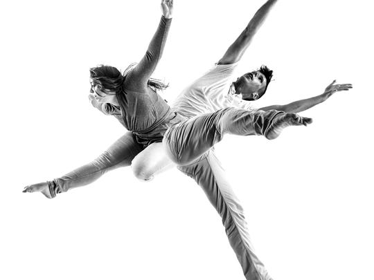 "Elena Rodriguez and Clint Fisher, members of MamLuft&Co. Dance, are seen in an excerpt from ""Double/Sided."""