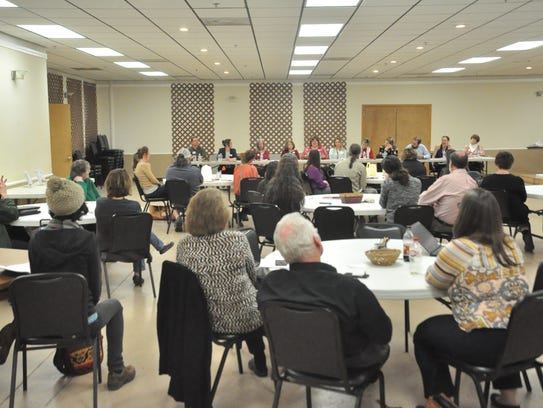Roughly 50 attendees engaged with local leaders on