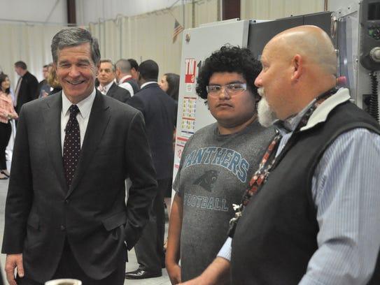 Madison High School teacher Vince Whitt (right) shares