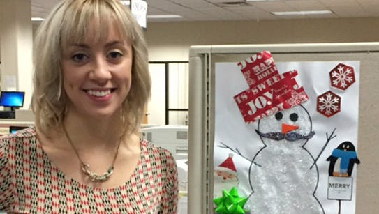FlipSidePA Editor Ashley May poses with her snowman,