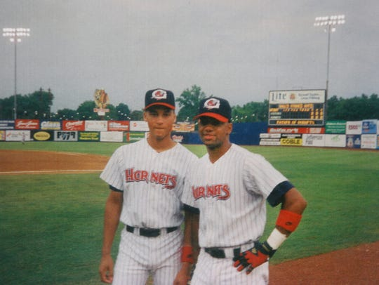 R. D. Long, right, with his friend and former teammate,