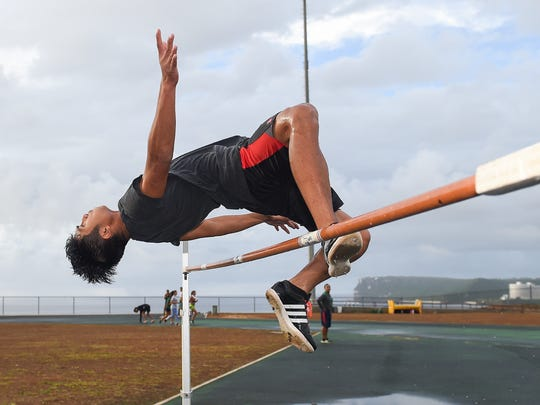 Guam Central Athletics member Daelan Alviz practices high jumps at the John F. Kennedy High School Track in Tamuning on June 21.
