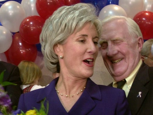 Kathleen Sebelius, just elected governor of Kansas, talks with her father, former Ohio governor John Gilligan, while her son Ned Sebelius is seen in the background, left, during Sebelius' victory speech on Nov. 5, 2002, in Topeka.