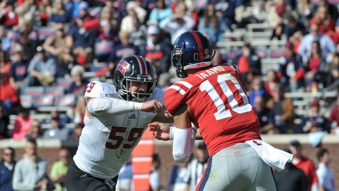 UL linebacker Jacques Boudreaux rushes Ole Miss quarterback Jordan Ta'amu (10) during a 2017 game.