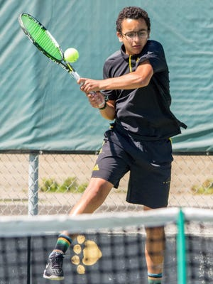 Freshman Ty Cohen rips a backhand during the Cougars' first-round playoff win Wednesday. Cohen won the Channel League singles title, beating teammate and fellow freshman Hunter Lelia.