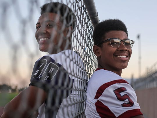 Brothers Christian, right, and Quintcy Egson at Shadow Hills High School on Tuesday, October 10, 2017 in Indio. Senior Quintcy Egson is a linebacker for Shadow Hills and  sophomore Christian Egson is the quarterback for La Quinta. The two will face-off this Friday.