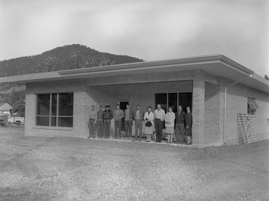 """Susan Lutterman and Doug Burgess identified some of the Community Public Service employees posing in front of their new building about 1960. From the left, Joe Jarvis, Aubrey Dobbs, unidentified, Wilbur Conley, Max McCoy and William """"Buck"""" Morrison. The rest are — for the moment — unidentified."""