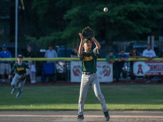 Middletown's  Kevin Toth pulls in the third out to end the second inning. Middletown Little League beats Brick in Section III action to force a playoff game.