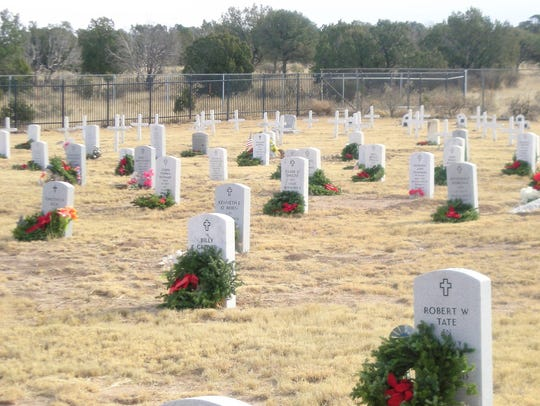 The nation remembers their sacrifice is the message of each wreath placed on veterans' graves at Christmas by volunteers. This effort centered on Fort Stanton Merchant Marine and Military Cemetery.