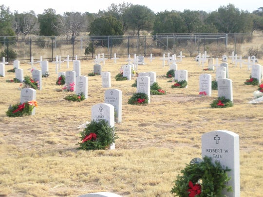 The nation remembers their sacrifice is the message of each wreath placed on veterans' graves. The local effort centered on Fort Stanton Merchant Marine and Military Cemetery.