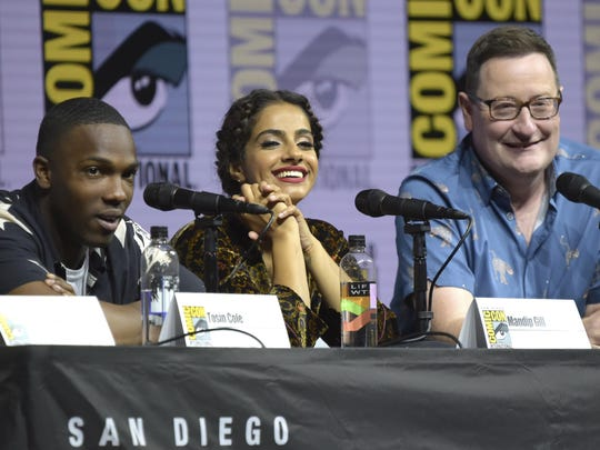 """Tosin Cole, from left, Mandip Gill and Chris Chibnall attend the """"Doctor Who"""" panel on day one of Comic-Con International on Thursday, July 19, 2018, in San Diego."""