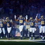 Nov 30, 2014; St. Louis, MO, USA; St. Louis Rams wide receiver Kenny Britt (81) puts his hands up to show support for Michael Brown before a game against the Oakland Raiders at the Edward Jones Dome. Mandatory Credit: Jeff Curry-USA TODAY Sports ORG XMIT: USATSI-180382 ORIG FILE ID:  20141130_gma_ac1_054.jpg