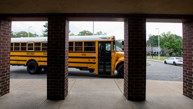 A school bus pulls up to E.D. Nixon Elementary School in Montgomery, Ala. on Thursday March 29, 2018.