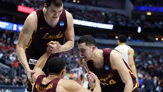 Loyola-Chicago Ramblers guard Ben Richardson (14) celebrates with Loyola-Chicago Ramblers guard Lucas Williamson (1) during the second half against the Tennessee Volunteers in the second round of the 2018 NCAA Tournament at American Airlines Center.