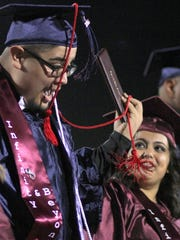 Tangled cords and diplomas were part of the celebration as 275 Deming High School seniors graduated Friday at DHS Memorial Stadium.