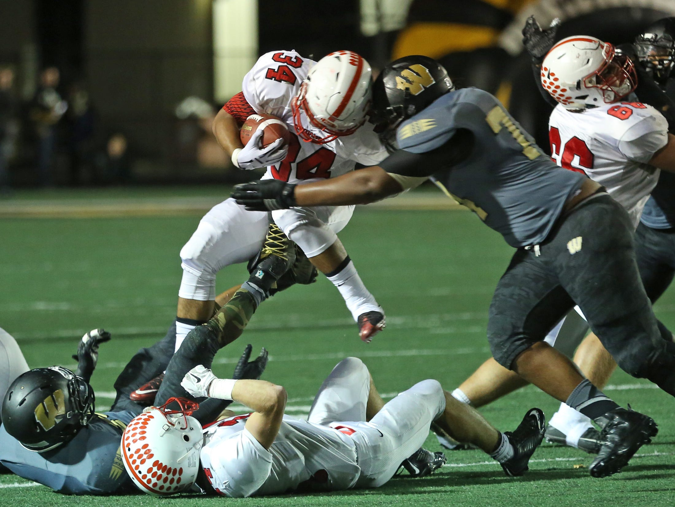 Center Grove's Triston Clark carries the ball against Warren Central Friday November 6, 2015 during the 6A Regionals at Warren Central.