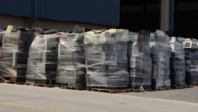 Electronics stacked outside the South Central Solid Waste Authority Transfer Station are wrapped in plastic. There will be no 2016 collection of electronics for recycling, as federal funding for a partner agency was cut in June.