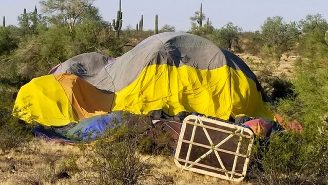 A hot-air balloon crashed in the desert by Lake Pleasant and Loop 303 on Aug. 31, 2017. Police found a deflated balloon and an empty basket when they arrived at the scene.