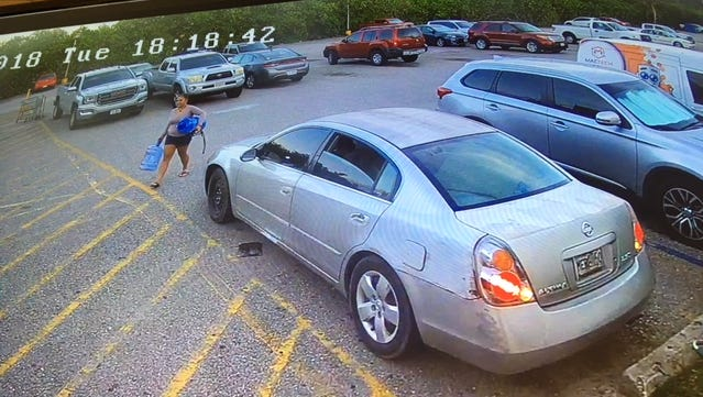A silver Nissan Altima parked at Agana Shopping Center, suspected to be the getaway vehicle used during the first theft incident at Vince Jewelers.