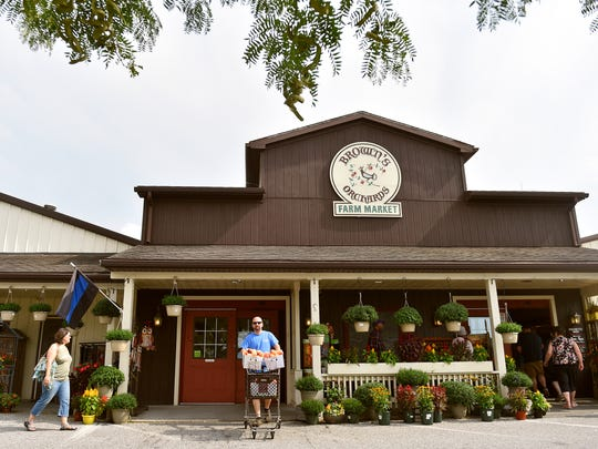 Customers enter and depart Brown's Orchards & Farm