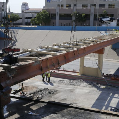 Crews work Friday morning to repair a Downtown overpass