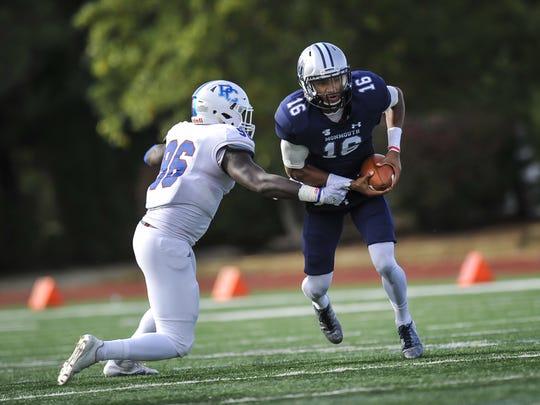 Monmouth University quarterback Kenji Bahar scrambles for yards against Presbyterian's Brien Washington during Saturday's game in West Long Branch on Nov. 4, 2017.