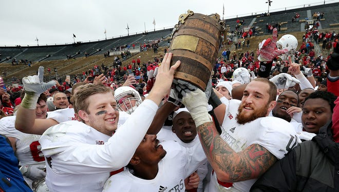 Indiana Hoosiers quarterback Nate Sudfeld (7),left, Rashard Fant and  Jason Spriggs (78),right, celebrate with the Old Oaken Bucket. The Indiana Hoosiers defeated the Purdue Boilermakers 56-36 to win the 118th Old Oaken Bucket game Saturday , November 28, 2015, afternoon at Ross-Ade Stadium in West Lafayette IN.