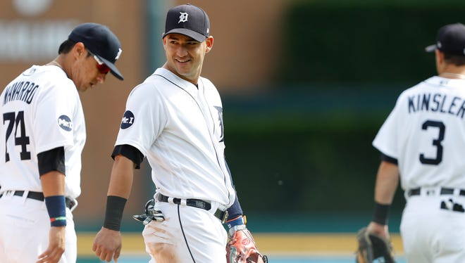 Tigers shortstop Jose Iglesias (1) smiles after a meeting on the mound during the fifth inning of the Tigers' 3-2 loss to the Indians in the first game of the doubleheader on Friday, Sept. 1, 2017, at Comerica Park.