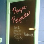 "The ""prayer request"" board in an Oak Grove classroom has been painted over."
