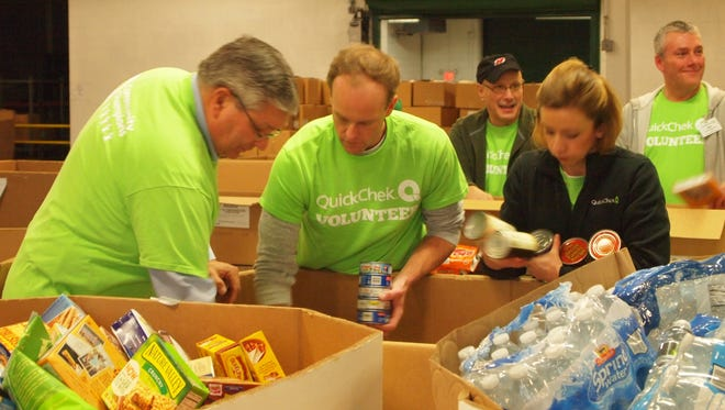 From left to right, QuickChek Vice President of Human Resources Bob Graczyk, District Leader Jon Durling and Community Involvement Coordinator Heather Stillman were among the 45 QuickChek team members who volunteered to help sort food at the Community FoodBank of New Jersey in Hillside on Dec. 17, aiding thousands of area families and individuals in need during the holiday season.