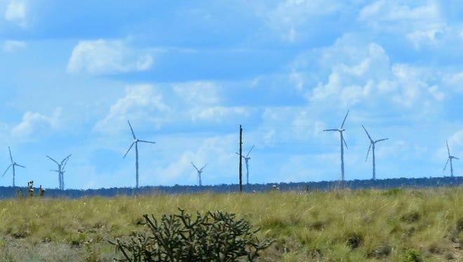 Wind turbines populate a mesa north of Corona.
