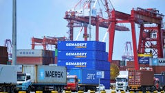 Containers are transferred at a port in Qingdao in