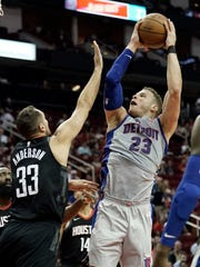 Detroit Pistons' Blake Griffin (23) shoots as Houston Rockets' Ryan Anderson (33) defends during the first half of an NBA basketball game Thursday, March 22, 2018, in Houston. (AP Photo/David J. Phillip)