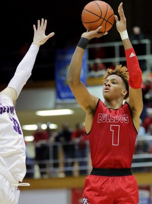 New Albany's Romeo Langford takes a shot against Seymour's Alex Hofer in the Class 4A Sectional semifinals. March 2, 2018