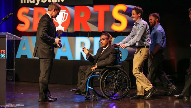 Alex Welch, of Lawrence North, wins the courage award during the third annual IndyStar Sports Awards held at Butler's Clowes Memorial Hall on Sunday, April 29, 2018.
