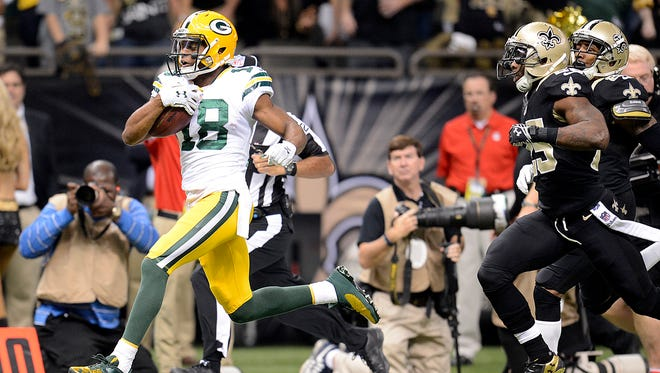 Green Bay Packers receiver Randall Cobb breaks away for a touchdown reception in the first quarter against the New Orleans Saints.