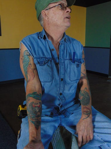 Veteran Larry Hickman shows off some of the tattoo work he has had done over the years.