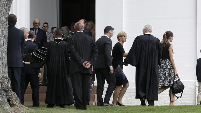 "Former New Jersey Gov. Christie Whitman, third right, greets a clergyman a she walks at Lamington Presbyterian Church, during funeral services for her husband John Whitman Thursday, July 9, 2015, in Bedminster, N.J. A spokesman for the former Republican governor said the state's first-ever first gentleman died July 2 at Morristown Medical Center after suffering a catastrophic brain injury in mid-June. He was 71. Christie Whitman called him ""a wonderful husband, father and grandfather."" She served as New Jersey governor from 1994 to 2001. (AP Photo/Mel Evans)"