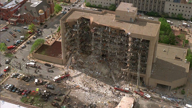 In this April 19, 1995, file photo, the north side of the Alfred Murrah Federal Building in Oklahoma City is missing after a vehicle bombing which killed 168 people. In 2018, the wave of mail-bombs targeting prominent Democrats, though yet to claim any victims, has angered and dismayed some of the people personally affected by past acts of political violence in the United States.
