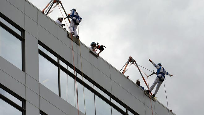 Sheryl Cook and Rusty Wallace rappel down the side of International Motorsports Center during Over the Edge at One Daytona fund raiser, Friday, Nov. 2, 2018. The event has been postponed from Aug. 27 to Nov. 18 this year amid the coronavirus pandemic.